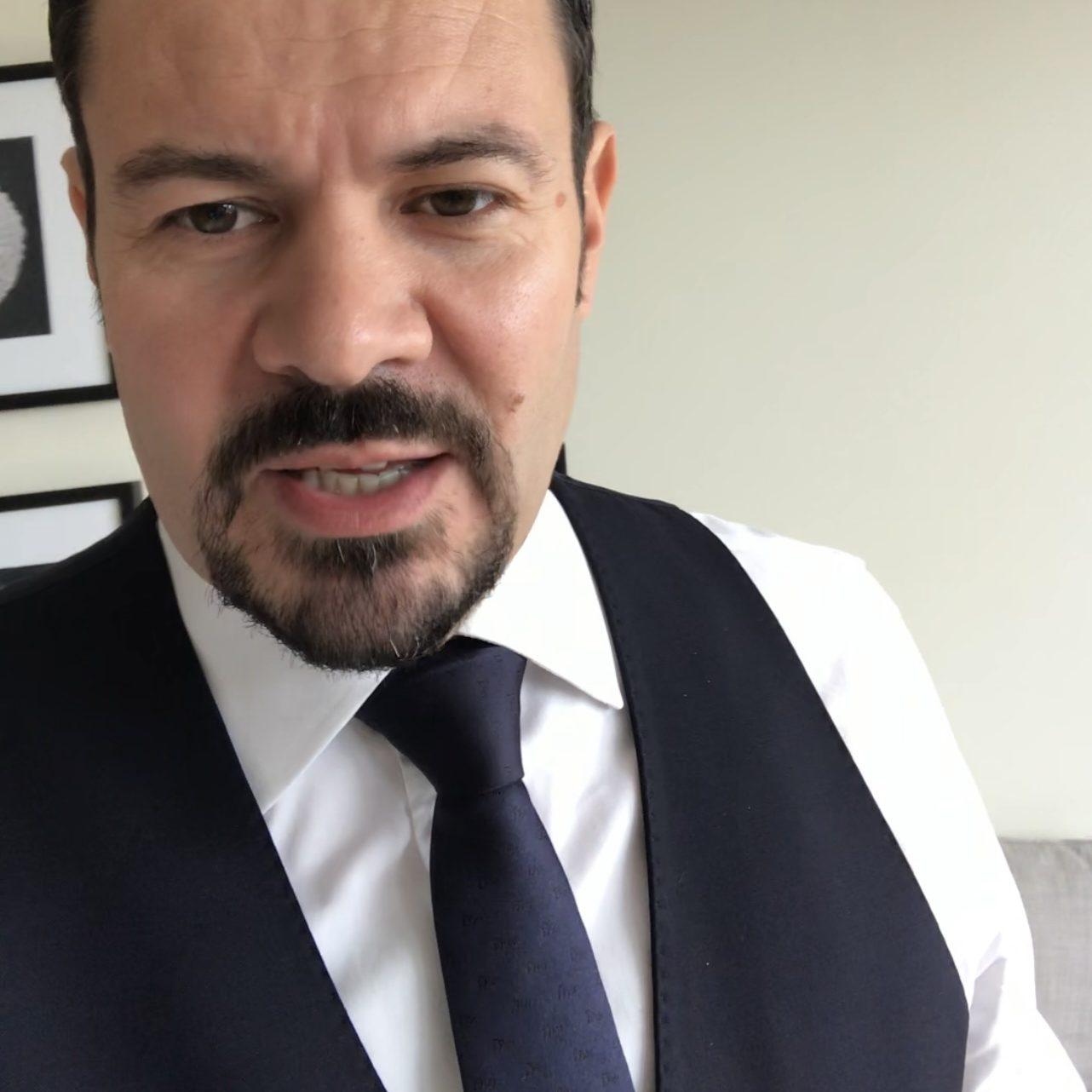 John M in a suit